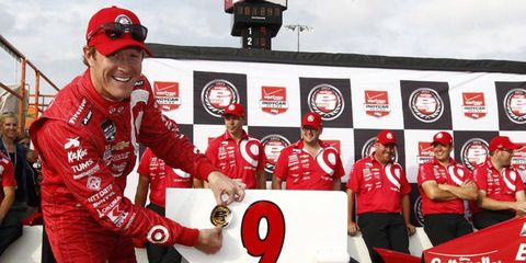 Scott Dixon celebrates his 21st career IndyCar Series pole following his record run on Friday at Iowa Speedway.