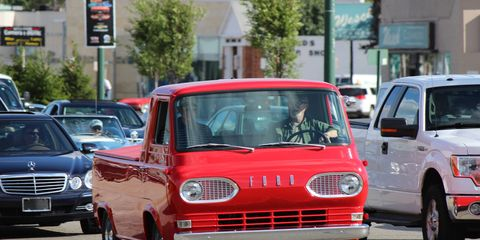 A red cab-over Ford pickup on Woodward