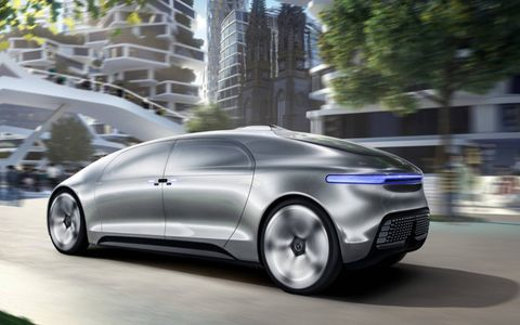 The Mercedes F015 cruises the city.