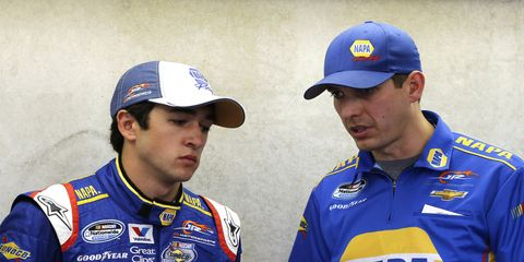Greg Ives talks to Chase Elliott. Ives will take over as Dale Earnhard Jr.'s crew chief in 2015.