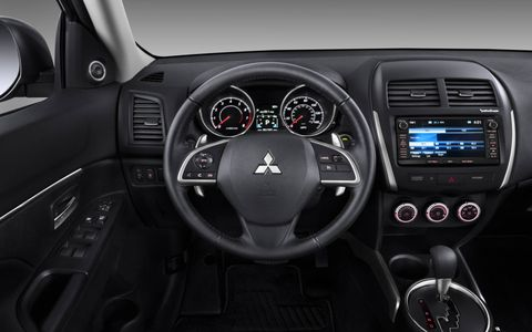 "The ""new car smell"" inside the 2014 Mitsubishi Outlander Sport SE is a little overwhelming."