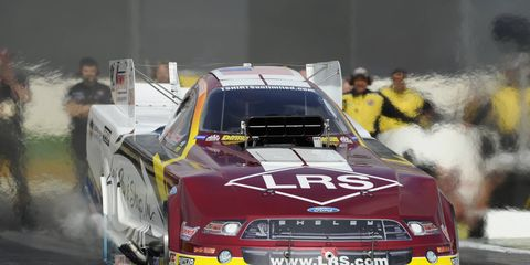 Tim Wilkerson won the top Funny Car qualifying spot in Houston on Saturday.