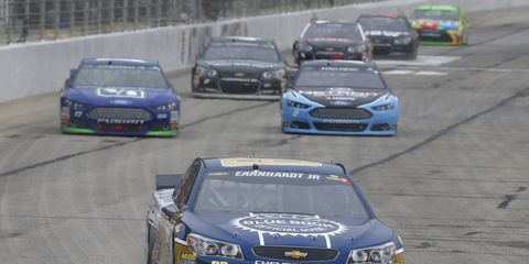 Dale Earnhardt Jr. picked up a piece of tape on his grille late in Sunday's NASCAR race. The tape slowed him down as he lost to teammate Jimmie Johnson.