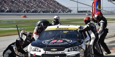 A cut tire sent Kevin Harvick into the wall and to an early exit in the first race of the Chase.