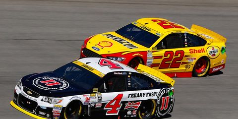 Joey Logano (22) had a hand in Kevin Harvick's early exit at Chicagoland.