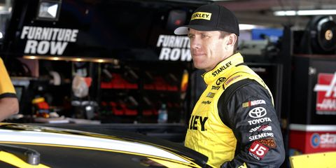 Carl Edwards didn't guarantee he'd win a NASCAR championship, but he did say his team, Joe Gibbs Racing, would be a factor in the final race of the season at Homestead.