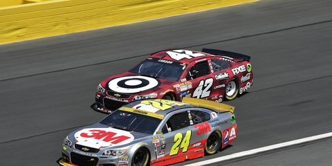 Jeff Gordon and Kyle Larson jockey for position on the track during a recent race.