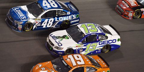 Casey Mears (13) spent most of the Daytona 500 running near the front. Here, he battles Jimmie Johnson (48) and Carl Edwards (19).