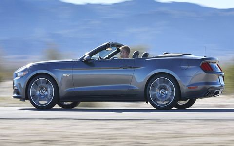 The 2015 Ford Mustang convertible comes with heated seats, if you specify the premium model.