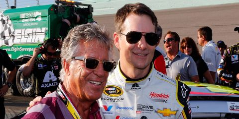 Mario Andretti, left, joins Jeff Gordon for a quick photo before Gordon's final NASCAR Sprint Cup Series race on Sunday at Homestead-Miami Speedway.