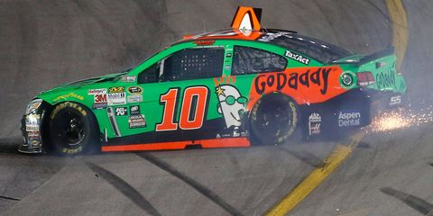 Dale Earnhardt Jr., who was battling brake issues, slammed Danica Patrick (10) into the wall late in the NASCAR Sprint Cup Series race at Kentucky Speedway on Saturday night.