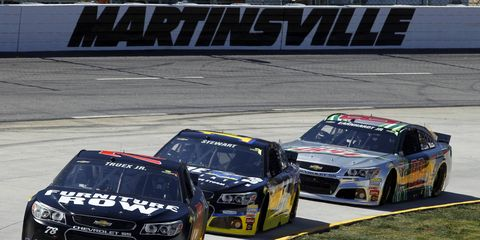 Martin Truex Jr., here leading a pack at Martinsville, is third in the NASCAR Sprint Cup Series standings heading into Saturday night's race at Richmond.