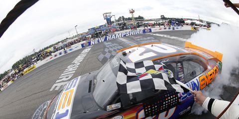 Denny Hamlin takes the checkered flag at New Hampshire Motor Speedway.