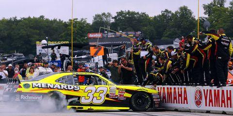 Paul Menard won Saturday's Xfinity race at Road America.