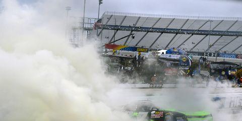 Regan Smith won at Dover on Saturday to keep his championship hopes alive.