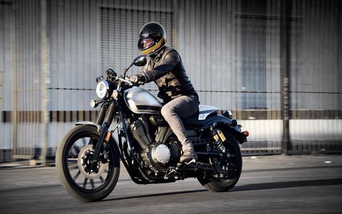 Cafe features include include clip-on handlebars (meaning they attach at the tops of the forks), traditional fork boots, a removable passenger seat cowl and sport café paint and graphics.