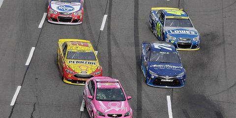 A Chevrolet SS pace car leads the field at Martinsville Speedway. For every lap the pink pace car led the field at Talladega and Martinsville, Chevrolet donated $350 to the American Cancer Society's Making Strides Against Breast Cancer campaign.