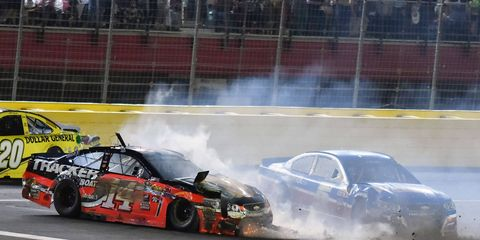 Tony Stewart (14) tangles with Kasey Kahne during Saturday Night's NASCAR Sprint All-Star Race. Stewart had some harsh words about the format after finishing last in the non-points race.