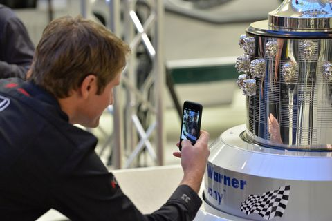 Ryan Hunter-Reay checks out his face on the Borg-Warner trophy.