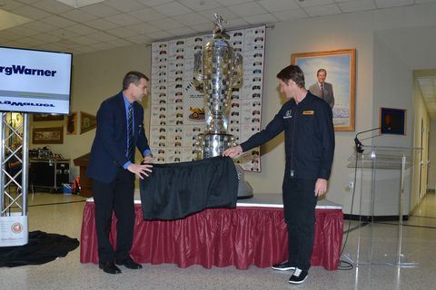 Hunter-Reay helps unveil the trophy.