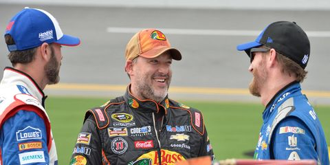 Tony Stewart, center, shares more than laughs with Hendrick Motorsports and drivers, Jimmie Johnson, left, and Dale Earnhardt Jr.