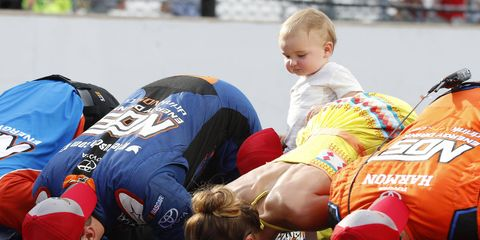 Kyle and Samantha Busch join the No. 18 Joe Gibbs Racing Toyota crew in kissing the bricks at Indianapolis Motor Speedway as Busch's son Brexton tries to figure it all out.