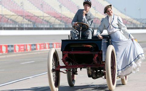 Brad Keselowski and NBC's Kelli Stavast enjoy a vintage 1901 ride at Michigan International Speedway on Friday.