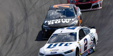 Brad Keselowski and Martin Truex battle in the latter stages of the NASCAR Sprint Cup Series race at Watkins Glen on Sunday.