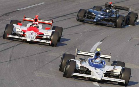 Buddy Rice leads Helio Castroneves and Marty Roth