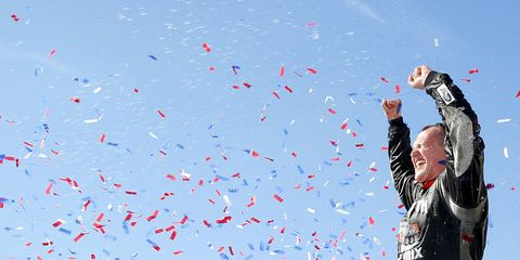 Ryan Preece climbs atop his MoHawk Northeast Inc. Toyota Camry for a Victory Lane celebration at Iowa.