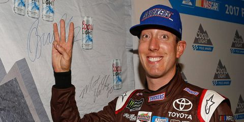 Kyle Busch celebrated winning his third pole of the Monster Energy NASCAR Cup Series season on Friday at Sparta, Kentucky.