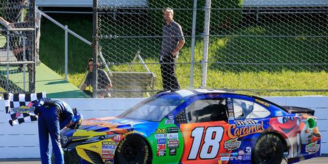 Kyle Busch bows to the crowd after winning Sunday at Pocono.
