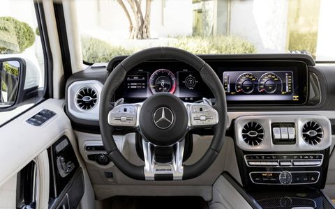 The interior of the 2019 Mercedes-AMG G63 is similar to that of the all-new G550, but features like the flat-bottomed AMG Performance steering wheel set it apart.