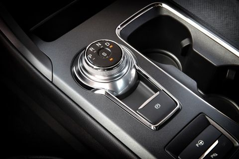 Accommodations inside included leather-trimmed seating and grippy, suede seat inserts, black headliner, carbon fiber appearance trim, and a modification to the rotary shifter – the letter L for low range changes to S for sport mode.
