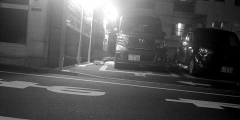 A long-exposure nighttime shot of a Honda NBOX kei van in Shinjuku.