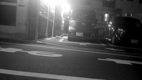 A long-exposure nighttime shot of a Honda NBOX kei van in Shinjuku.