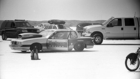 Marvin McIntire prepares to race his Pontiac. Photographed with 1966 Argus C3 Matchmatic camera, Soligor 135mm lens, Fomapan 100 film.