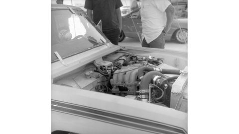 This is a turbocharged 13B rotary in a Mazda Rotary Engine Pickup. Photographed with 1958 Yashica-44 camera, Rera Pan 100 film.