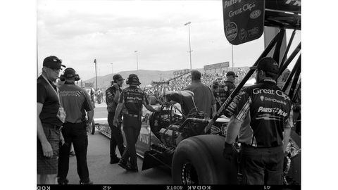 Here's Clay Millican's Top Fuel team getting set to run a 3.826-second pass. Photographed with 1910 Ansco Buster Brown No. 2 Folding camera, Kodak Tri-X film.