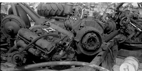 A 1970s Detroit pushrod V8, a 1940s Detroit flathead V8, and a 1919 German camera.