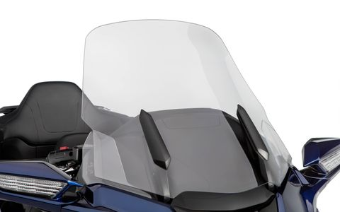 The windscreen raises and lowers electrically.