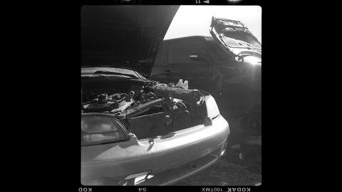 Vehicle, Black, Car, Vehicle door, Automotive design, Automotive exterior, Personal luxury car, Photography, Hood, Bumper,