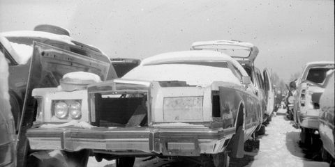 This snow-covered 1979 Bill Blass Edition Lincoln Mark V looks very forlorn when photographed with a Vest Pocket Kodak film camera.