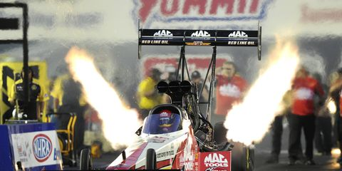 Doug Kalitta was fast at his home track on Friday with an elapsed-time record.