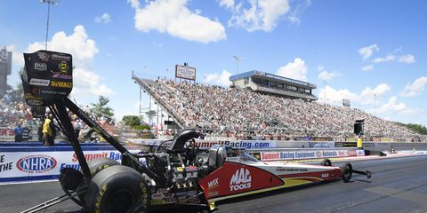 Doug Kalitta maintained his advantage atop the Top Fuel category with an elapsed time track-record run of 3.709-second pass at 327.43 mph.