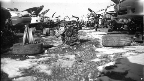 Rollei Retro 80S film. There is always something sad about a junkyard engine pulled and then left behind in the snow.