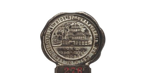 The very first Indy 500 pit badge was produced by the St. Louis Button Co. It features the pagoda at Indianapolis Motor Speedway.