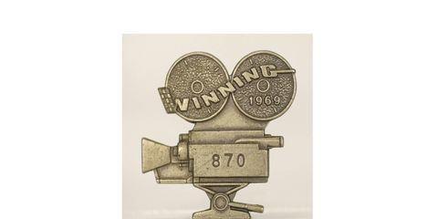 """The pit badge for the 1969 Indianapolis 500 was shaped like a movie camera to celebrate the film """"Winning,"""" which was partially shot at Indianapolis Motor Speedway."""