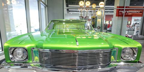 """The lowrider exhibit at the Petersen Automotive Museum in Los Angeles was so door-bustin' popular that they added four more cars in the lobby. Here are three of them. This is Jose Alvarez' 1972 Monte Carlo """"Fatal Attraction"""""""