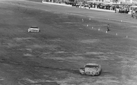 1976: They'll be talking about this one as long as there is motorsports. David Pearson and Richard Petty, the giants of the sport in the mid-1970s, sailed into the final turn of the final lap side by side, the checkered flag about to be unfurled. They crashed into each other and the outside wall, both cars spinning off the trioval banking. Pearson, who had earned the nickname the Silver Fox for just such a move, kept a clear head and depressed the clutch in his car to keep the engine running. He chugged across the finish line at about 30 miles per hour to score his only 500 win.